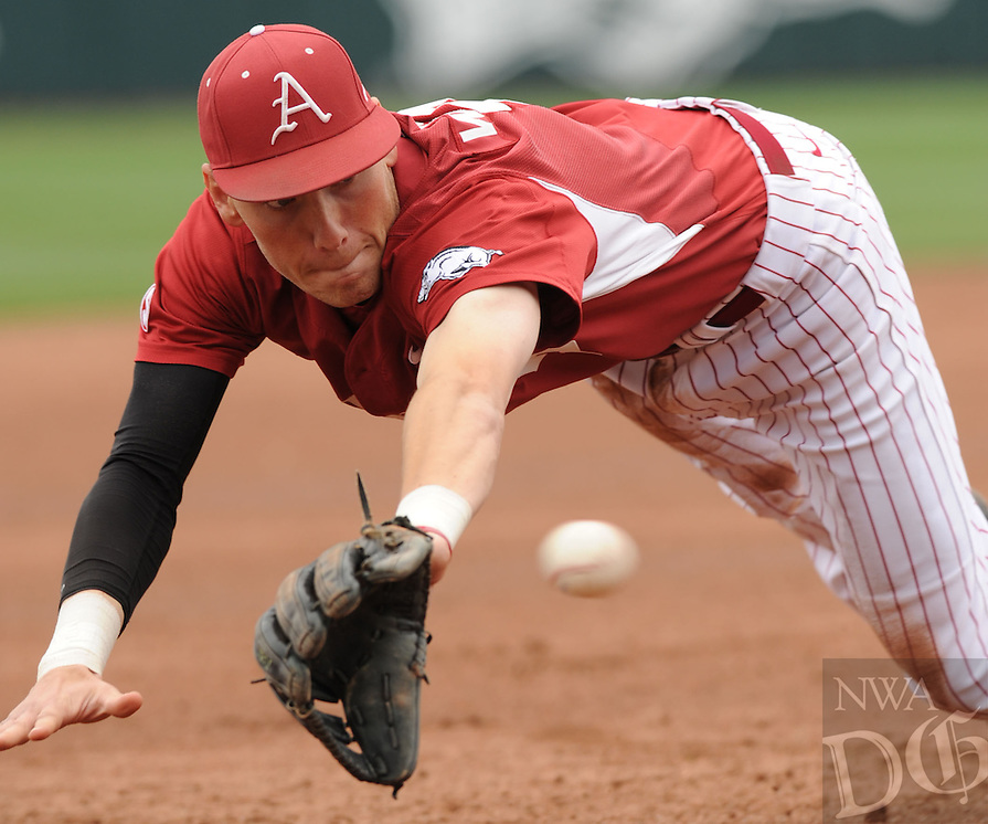 NWA Democrat-Gazette/ANDY SHUPE - Third baseman Bobby Wernes of Arkansas makes a play on a ball hit down the left field line against LSU during the second inning Saturday, March 21, 2015, at Baum Stadium in Fayetteville. Visit nwadg.com/photos for more photos from the game.