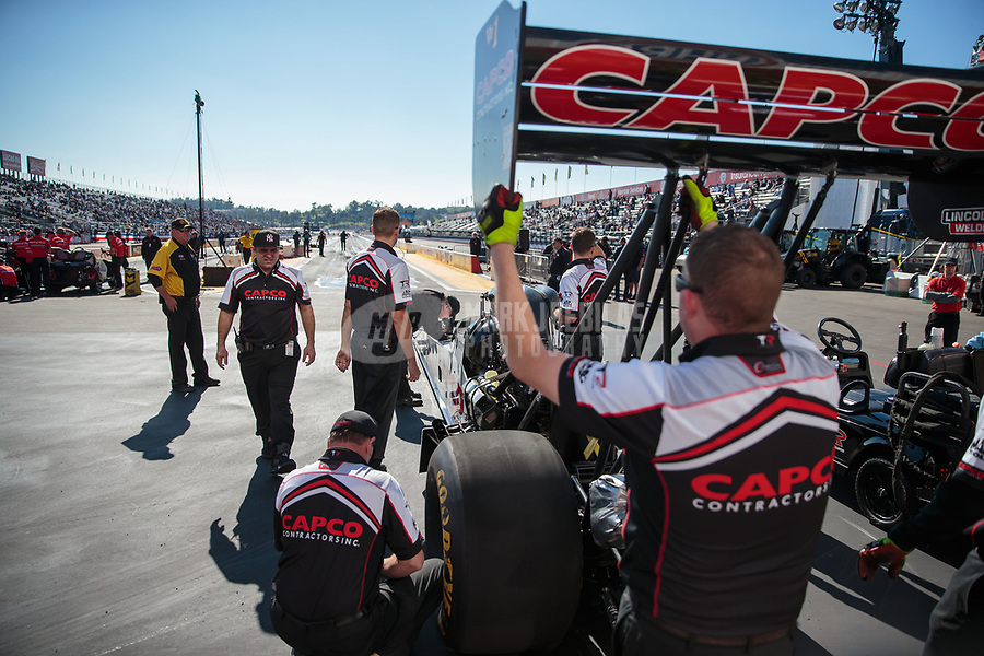 Feb 8, 2019; Pomona, CA, USA; Crew members for NHRA top fuel driver Steve Torrence during qualifying for the Winternationals at Auto Club Raceway at Pomona. Mandatory Credit: Mark J. Rebilas-USA TODAY Sports