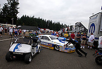 Aug. 4, 2013; Kent, WA, USA: Crew members push the car of NHRA pro stock driver Allen Johnson out of the pits during the Northwest Nationals at Pacific Raceways. Mandatory Credit: Mark J. Rebilas-USA TODAY Sports