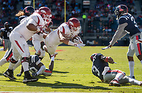 Hawgs Illustrated/BEN GOFF <br /> Cheyenne O'Grady, Arkansas tight end, dives into the end zone for a touchdown, with blocking from tackle Johnny Gibson, in the third quarter against Ole Miss Saturday, Oct. 28, 2017, at Vaught-Hemingway Stadium in Oxford, Miss.