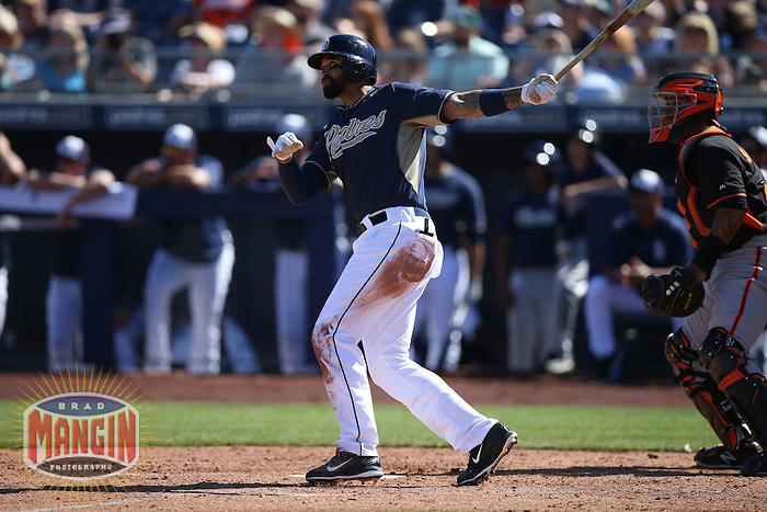 PEORIA, AZ - MARCH 10:  Matt Kemp of the San Diego Padres bats against the San Francisco Giants during a spring training game at the Peoria Sports Complex on March 10, 2015 in Peoria, Arizona. (Photo by Brad Mangin)