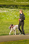 Seward Park, Seattle Parks and Recreation. Woman walking dogs