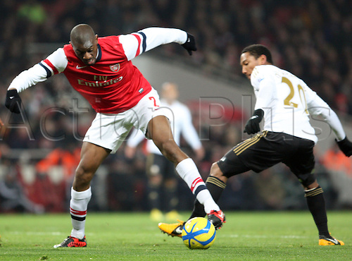 16.01.2013. London, England. Jabou Diaby of Arsenal and Jonathan de Guzman of Swansea City (on loan from Villarreal)in action during The FA Cup 3rd Round replay with Budweiser game between Arsenal and Swansea City from Emirates Stadium.