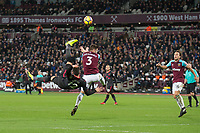 Olivier Giroud of Arsenal tries an overhead kick but catches Aaron Cresswell of West Ham United during the Premier League match between West Ham United and Arsenal at the Olympic Park, London, England on 13 December 2017. Photo by Andy Rowland.