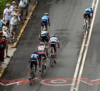Yaroslav Popovych (upper right), a Discovery Channel Pro Cycling Team racer from Ukraine, leads (top to bottom) Discovery Channel's Egoi Martinez, Health Net's Karl Menzies, Davitamon-Lotto's Fred Rodriguez, Toyota-United Pro's Juan Jos&eacute; Haedo, and Navigators Insurance Team's Cesar Grajales up East Second Street, known as &quot;Clocktower Hill,&quot; during Stage 2 of the 2006 Ford Tour de Georgia pro cycling race. Popovych won the 116.1-mile stage from Fayetteville to Rome in 4:47:39.<br />