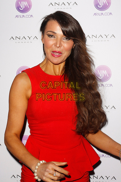 Lizzie Cundy.Pro Lashes by Gary Cockerill Launh Party, Charles Fox Kryolan, London, England, UK, November 29th, 2012..half length red dress peplum mouth open funny  tanned  sleeveless .CAP/AH.©Adam Houghton/Capital Pictures.