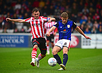 Lincoln City's Lee Frecklington vies for possession with  Crewe Alexandra's James Jones<br /> <br /> Photographer Andrew Vaughan/CameraSport<br /> <br /> The EFL Sky Bet League Two - Lincoln City v Crewe Alexandra - Saturday 6th October 2018 - Sincil Bank - Lincoln<br /> <br /> World Copyright &copy; 2018 CameraSport. All rights reserved. 43 Linden Ave. Countesthorpe. Leicester. England. LE8 5PG - Tel: +44 (0) 116 277 4147 - admin@camerasport.com - www.camerasport.com
