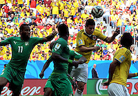 BRASILIA - BRASIL -19-06-2014. James Rodriguez (#10) jugador de Colombia (COL) disputa el balón con Didier DROGBA (#11) jugador de  Costa de Marfil (CIV) durante partido del Grupo C de la Copa Mundial de la FIFA Brasil 2014 jugado en el estadio Mané Garricha de Brasilia./ James Rodriguez (#10) player of Colombia (COL) fights the ball with Didier DROGBA (#11) player of Ivory Coast (CIV) during the macth of the Group C of the 2014 FIFA World Cup Brazil played at Mane Garricha stadium in Brasilia. Photo: VizzorImage / Alfredo Gutiérrez / Contribuidor