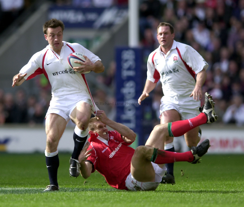 Photo. Richard Lane.Lloyds TSB Six Nations Championship. England v Wales at Twickenham. 23-3-2002.Dan Luger breaks the tackle of Dafydd James.