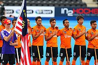 Players from Malaysia line up for the national anthems during the Hockey World League Quarter-Final match between India and Malaysia at the Olympic Park, London, England on 22 June 2017. Photo by Steve McCarthy.