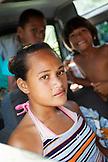 FRENCH POLYNESIA, Moorea Island. Kids in a car.
