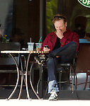 May 4th   2012   Exclusive..Conan O'brien Obrien drinking a Starbucks coffee & text messaging on his phone while picking his nose. Conan was talking to a Jewish Rabbis at the Beverly Glen shopping center in Los Angeles. .Then 6 foot 7 inch Conan managed to fit inside a Mini Cooper as he left ..AbilityFilms@yahoo.com.805-427-3519.www.AbilityFilms.com.