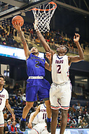 Washington, DC - December 22, 2018: Howard Bison center Akuwovo Ogheneyole (12) tries to block Hampton Pirates guard Jermaine Marrow (2) layup during the DC Hoops Fest between Hampton and Howard at  Entertainment and Sports Arena in Washington, DC.   (Photo by Elliott Brown/Media Images International)