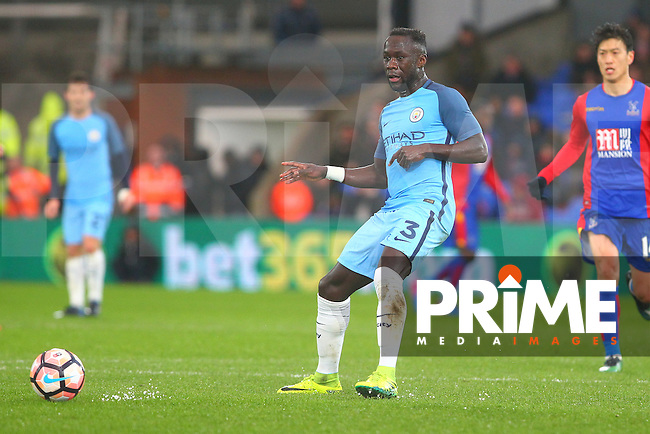 Manchester City defender Bacary Sagna passes the ball to midfield during the FA Cup fourth round match between Crystal Palace and Manchester City at Selhurst Park, London, England on 28 January 2017. Photo by PRiME Media Images / Steve McCarthy.