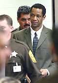 Sniper Suspect John Allen Muhammad is led into court by sheriff deputies after a break in his trial in Virginia Beach Circuit Court in Virginia Beach, Virginia, November 6, 2003. <br /> Credit: Tracy Woodward - Pool via CNP