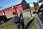 ROMa kids outside the Pentecostal church in South Romania, Barbulesti. 15 years ago the population of Barbulesti, a village inhabited mostly by Roma people sittuated in the south of Romania,  started to convert to the Pentecostal Church. Belivers say that conversion led to a decrease in crime in the area, although official statistics do not confirm it.