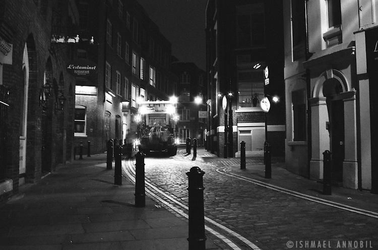 DUSTCART IN QUIET SIDE STREET, LONDON