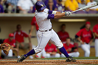LSU Tigers outfielder Mason Katz #8 drives in the winning run in the 12th inning of the continuation of their suspended NCAA Super Regional baseball game against Stony Brook on June 9, 2012 at Alex Box Stadium in Baton Rouge, Louisiana. LSU defeated Stony Brook 5-4. (Andrew Woolley/Four Seam Images)