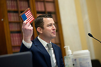 Joe Shamess, Co-Founder of Flags of Valor, holds up an American flag as he testifies before the United States Senate Committee on Small Business and Entrepreneurship on Capitol Hill in Washington D.C., U.S., on Wednesday, June 3, 2020.  Credit: Stefani Reynolds / CNP/AdMedia