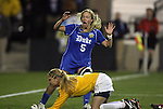 02 December 2011: Duke's Kaitlyn Kerr (5) starts to celebrate after Wake Forest's Aubrey Bledsoe (below) is beaten for a goal by Duke's Kim DeCesare (not pictured). The Duke University Blue Devils played the Wake Forest University Demon Deacons at KSU Soccer Stadium in Kennesaw, Georgia in an NCAA Division I Women's Soccer College Cup semifinal game.