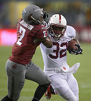SEATTLE, WA - September 28, 2013: Stanford running back Anthony Wilkerson rushes the ball against the Washington State defensive back Nolan Washington during play at CenturyLink Field. Stanford won 55-17