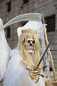 "Venice, Italy, 8 February 2015. A person wears an ""Angel of Death"" costume. People wear traditional masks and costumes to celebrate the 2015 Carnival in Venice. carnivalpix/Alamy Live News"