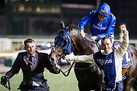 DUBAI, UNITED ARAB EMIRATES - MARCH 25: Jack Hobbs #2 ridden by William Buick (blue hat), takes a victory walk after winning the Longines Dubai Shemma Classic at Meydan Racecourse during Dubai World Cup Day on March 25, 2017 in Dubai, United Arab Emirates. (Photo by Douglas DeFelice/Eclipse Sportswire/Getty Images)