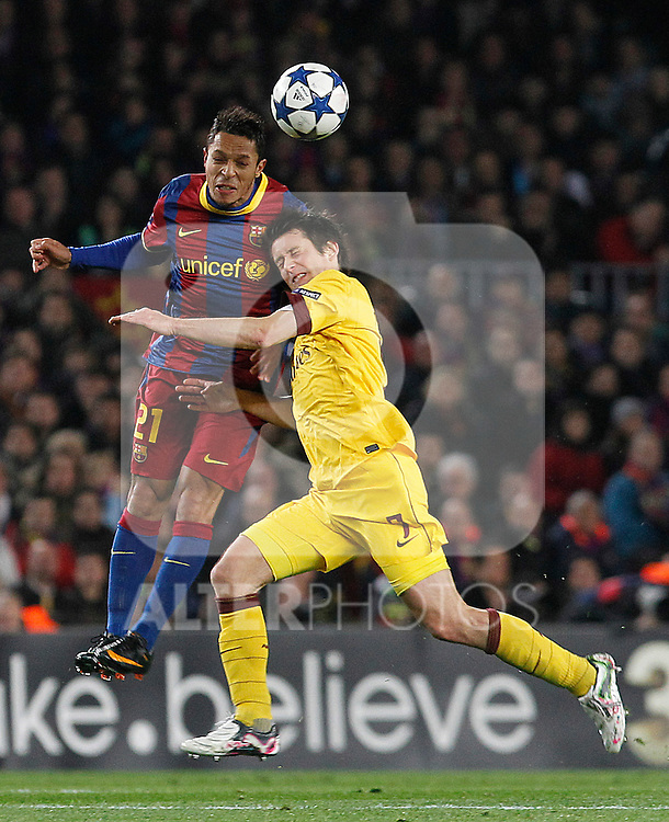 FC Barcelona's Adriano Correia (l) and Arsenal's Tomas Rosicky during UEFA Champions League match.March 8,2011. (ALTERPHOTOS/Acero)