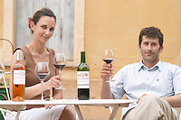 Christophe Blanc and his wife Chateau de Montpezat. Pezenas region. Languedoc. Owner winemaker. Tasting wine. France. Europe. Bottle.