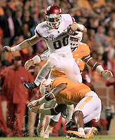 Arkansas Democrat-Gazette/BENJAMIN KRAIN --10/3/15--<br /> Arkansas wide receiver Drew Morgan leaps over Tennessee defender Kahlil McKenzie for a big gain in the first quarter. The Hogs scored a touchdown on the drive.