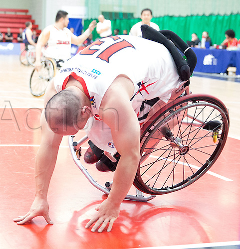 03.07.2016. Leicester Sports Arena, Leicester, England. Continental Clash Wheelchair Basketball, USA versus Japan.  Mitsugu Chiwaki (JPN) falls over during play