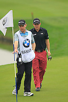 Richie Ramsay (SCO) and caddy Ryan on the 3rd green during Thursday's Round 1 of the 2014 BMW Masters held at Lake Malaren, Shanghai, China 30th October 2014.<br /> Picture: Eoin Clarke www.golffile.ie
