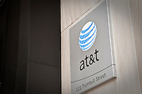 An AT&T logo is pictured on an office building in Hartford, Connecticut, Saturday August 6, 2011. AT&T Inc. (NYSE: T) is an American multinational telecommunications corporation and largest provider of mobile telephony and fixed telephony in the United States.