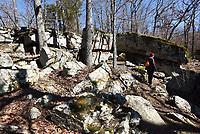 NWA Democrat-Gazette/FLIP PUTTHOFF <br /> Denise Nemec explores a rocky area at Lake Wilson Park in Fayetteville.