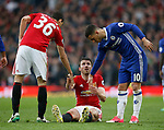 Michael Carrick of Manchester United helped up by Matteo Darmian of Manchester United and Eden Hazard of Chelsea during the English Premier League match at Old Trafford Stadium, Manchester. Picture date: April 16th 2017. Pic credit should read: Simon Bellis/Sportimage