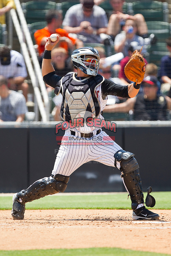 Kevin Dubler #27 of the Kannapolis Intimidators makes a throw to second base against the Hagerstown Suns at Fieldcrest Cannon Stadium on May 30, 2011 in Kannapolis, North Carolina.   Photo by Brian Westerholt / Four Seam Images