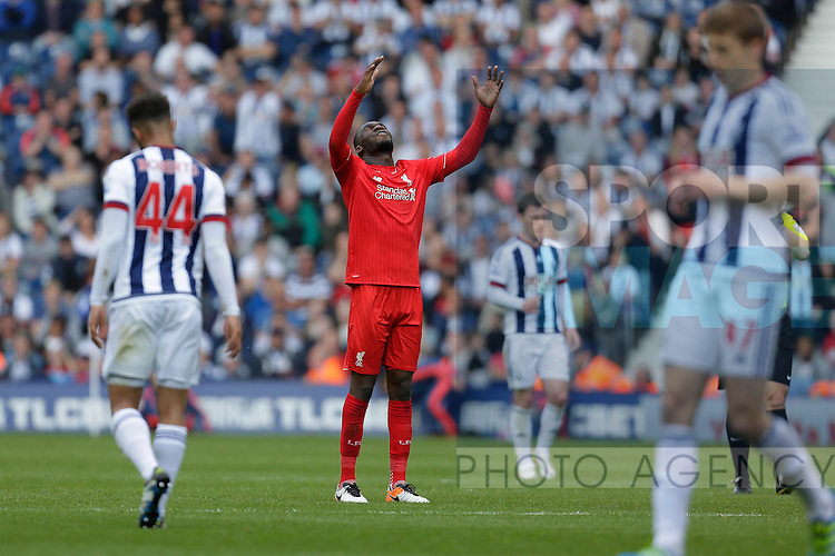 Christian Benteke of Liverpool looks frustrated at the final whistle during the Barclays Premier League match at The Hawthorns.  Photo credit should read: Malcolm Couzens/Sportimage