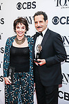 NEW YORK, NY - JUNE 10:  Brooke Adams and Tony Shalhoub, winner of the award for Best Performance by an Actor in a Leading Role in a Musical for 'The Band's Visit,' pose in the 72nd Annual Tony Awards Press Room at 3 West Club on June 10, 2018 in New York City.  (Photo by Walter McBride/WireImage)