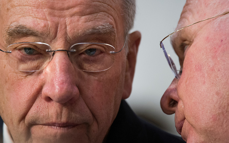 UNITED STATES - JANUARY 28: Chairman Chuck Grassley, R-Iowa, left, speaks with ranking member Pat Leahy, D-Vt., during the confirmation hearing for U.S. Attorney General nominee Loretta Lynch in the Senate Judiciary Committee on Wednesday, Jan. 28, 2015. (Photo By Bill Clark/CQ Roll Call)