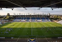 The teams warm up to a empty looking stadium during the The Checkatrade Trophy match between Oxford United and Exeter City at the Kassam Stadium, Oxford, England on 30 August 2016. Photo by Andy Rowland / PRiME Media Images.