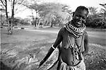 A Turkana woman  and food bowl in a traditional village near Kakuma, Northern Kenya.