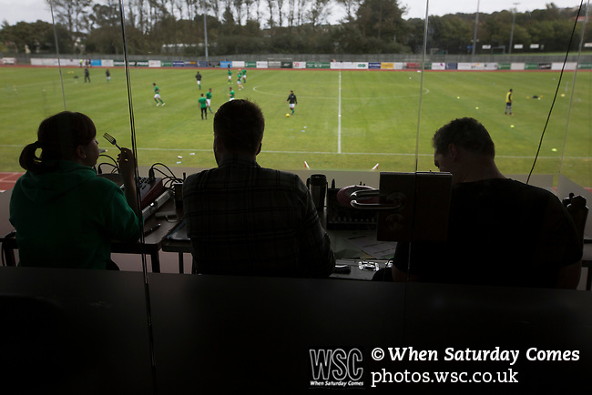 Guernsey 0 Corinthian-Casuals 1, 10/09/2017. Footes Lane, Isthmian League Division One. The PA announcer and journalists watching the players warming-up as Guernsey take on Corinthian-Casuals in a Isthmian League Division One South match at Footes Lane. Formed in 2011, Guernsey FC are a community club located in St. Peter Port on the island of Guernsey and were promoted to the Isthmian League Division One South in 2013. The visitors from Kingston upon Thames won the fixture by 1-0, watched by a crowd of 614 spectators. Photo by Colin McPherson.