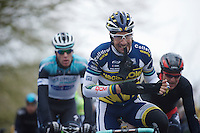 Gent-Wevelgem 2013.Juan Antonio Flecha (ESP) getting rid of his gloves on top of the Kemmelberg (2nd ascent).