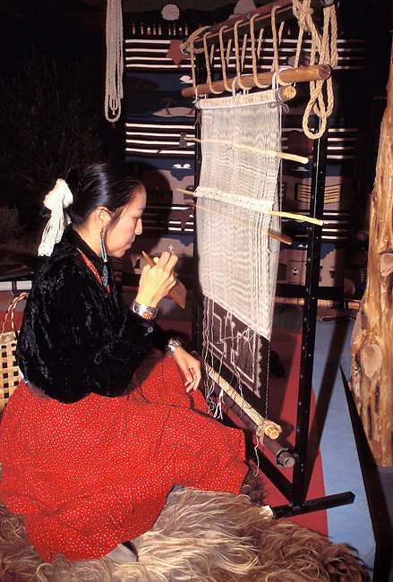 Navajo weaver, Nanabah, demonstrates weaving of a traditional Navajo wool rug in Salt Lake City Utah