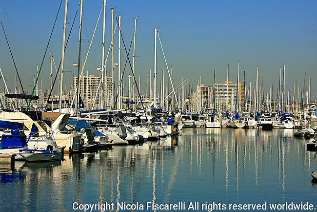 The  reflection of  Sailboats  docked in Long Beach California marina