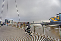 Pictured: A cyclist on the Newport City footbridge in Newport, Wales, UK. Thursday 14 February 209<br /> Re: The city of Newport is preparing to host the FA Cup match between Newport County and Manchester City at Rodney Parade, Newport, Wales, UK.