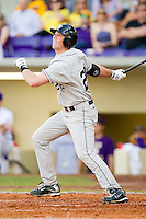 Charlie Morgan #26 of the Wake Forest Demon Deacons follows through on a solo home run in the top of the 9th inning against the LSU Tigers at Alex Box Stadium on February 19, 2011 in Baton Rouge, Louisiana.  The Tigers defeated the Demon Deacons 4-3.  Photo by Brian Westerholt / Four Seam Images
