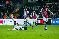 Bafetibi Gomis of Swansea City  lies injured in the dying minutes of the  Barclays Premier League match between Swansea City and Aston Villa played at the Liberty Stadium, Swansea  on March the 19th 2016