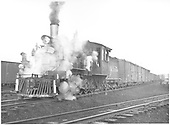 3/4 fireman's-side view of D&amp;RGW #268 with a freight train at Gunnison.<br /> D&amp;RGW  Gunnison, CO  Taken by Vollrath, Harold K. - 6/1942