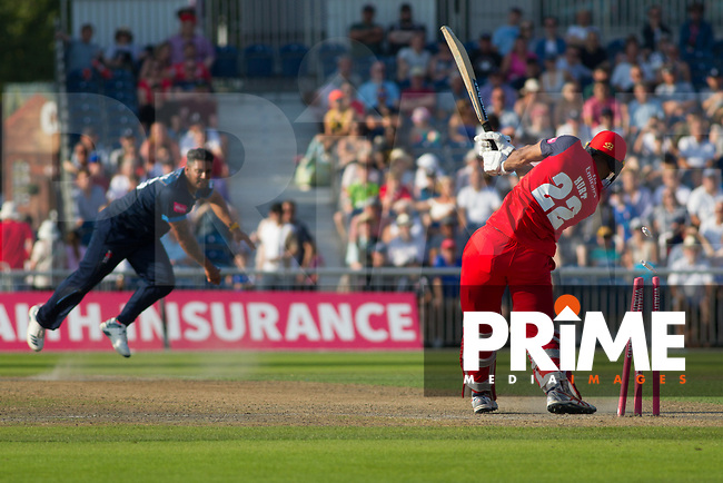 Ravi Rampaul of the West Indies bowls out Liam Hurt of Lancashire during the Vitality T20 Blast match between Lancashire Lightning and Derbyshire Falcons at Old Trafford Cricket Ground, Manchester on 26 August 2019. Photo by James  Gill.